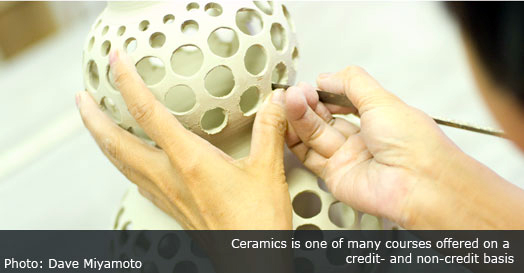 Woman making artistic ceramic vessel